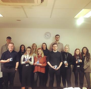 Apprentice ambassadors together for 'Tea & Chat' during National Apprenticeship Week, holding themed mugs