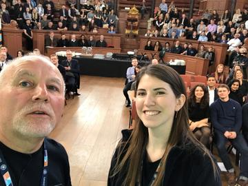 Apprenticeship team selfie at University of Oxford Apprenticeship expo & awards with crowd for hashtag competition